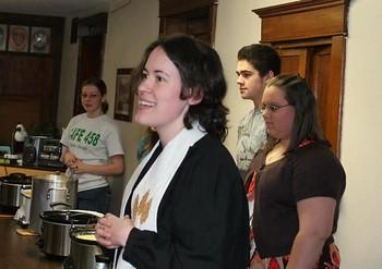 Rev. Elizabeth Campbell-Maleke blesses Souper Bowl of Caring meal.