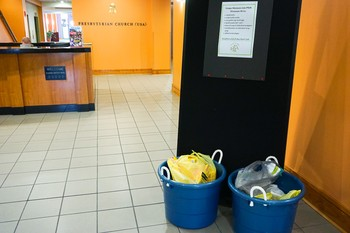 PDA collection buckets in the lobby of the Presbyterian Center in Louisville.