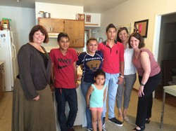 Laurie Kraus (left) and Susan Krehbiel (right) with Presbyterian Disaster Assistance, meet with a family from Guatamala who are staying at a welcome home after release from a family detention center in Karnes, Texas.