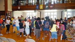Freedom School children begin their day with motivational song and Harambee celebration.