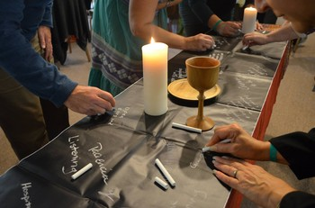 Prayers and hopes are written during communion at the conference on race, ethnicity, racism and ethnocentricity held at Stony Point Conference Center in New York.