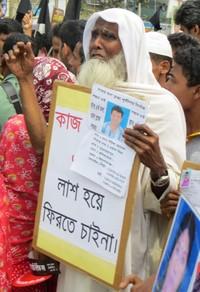 Family members of those lost two years ago gathered today at the site of the Rana Plaza collapse to honor their memories and demand work with dignity in the future.