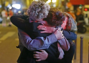 People hug on the street near the Bataclan concert hall after the fatal attacks in Paris. Gunmen and bombers attacked multiple locations around the city on Friday evening (Nov. 13, 2015), killing scores of people in what a shaken French president described as an unprecedented terrorist attack.
