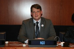 Ryan Smith, Presbyterian Representative to the United Nations, prepares to speak to the 59th Session of the UN Commission on the Status of Women.