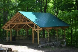 "Volunteer alumni of Camp Holmes not only built, but raised $21,000, for their 25th anniversary ""Raising the Scudder Roof"" project completed in May."