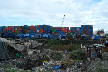 Stacks of shipping containers in the Philippines that companies park near landfill sites.