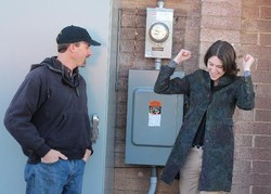 Rachel Davis celebrates flipping the switch to solar power in January, 2012.