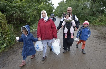 A Syrian refugee family enters Serbia after fleeing fighting in their home country.