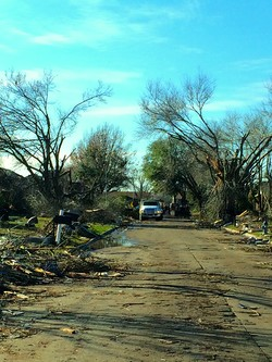 A neighborhood street in Rowlett, Texas, heavily damaged by an EF3 tornado. As many as 446 homes were damaged and 23 people were injured.