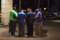 small prayer circle formed near where police responded to a shooting at the Emanuel AME Church in Charleston, S.C., on June 17, 2015. A gunman opened fire that evening at the historic African-American church in downtown Charleston.
