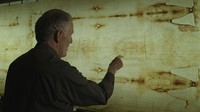"John Jackson of the Turin Shroud Center of Colorado examines the Shroud of Turin in CNN's series ""Finding Jesus."""