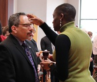 Tony De La Rosa, interim executive director of the Presbyterian Mission Agency, receives ashes from Simone Adams‐Andrade, coordinator for budget and mission effectiveness in Theology, Formation & Evangelism, during Ash Wednesday services at the Presbyterian Center in Louisville.