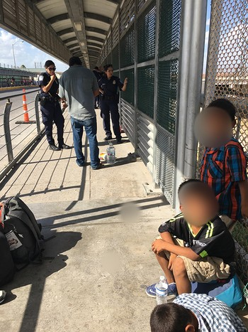 Asylum-seeking family stopped pedestrian bridge in Mexico by U.S. Customs and Border Patrol - Summer 2018