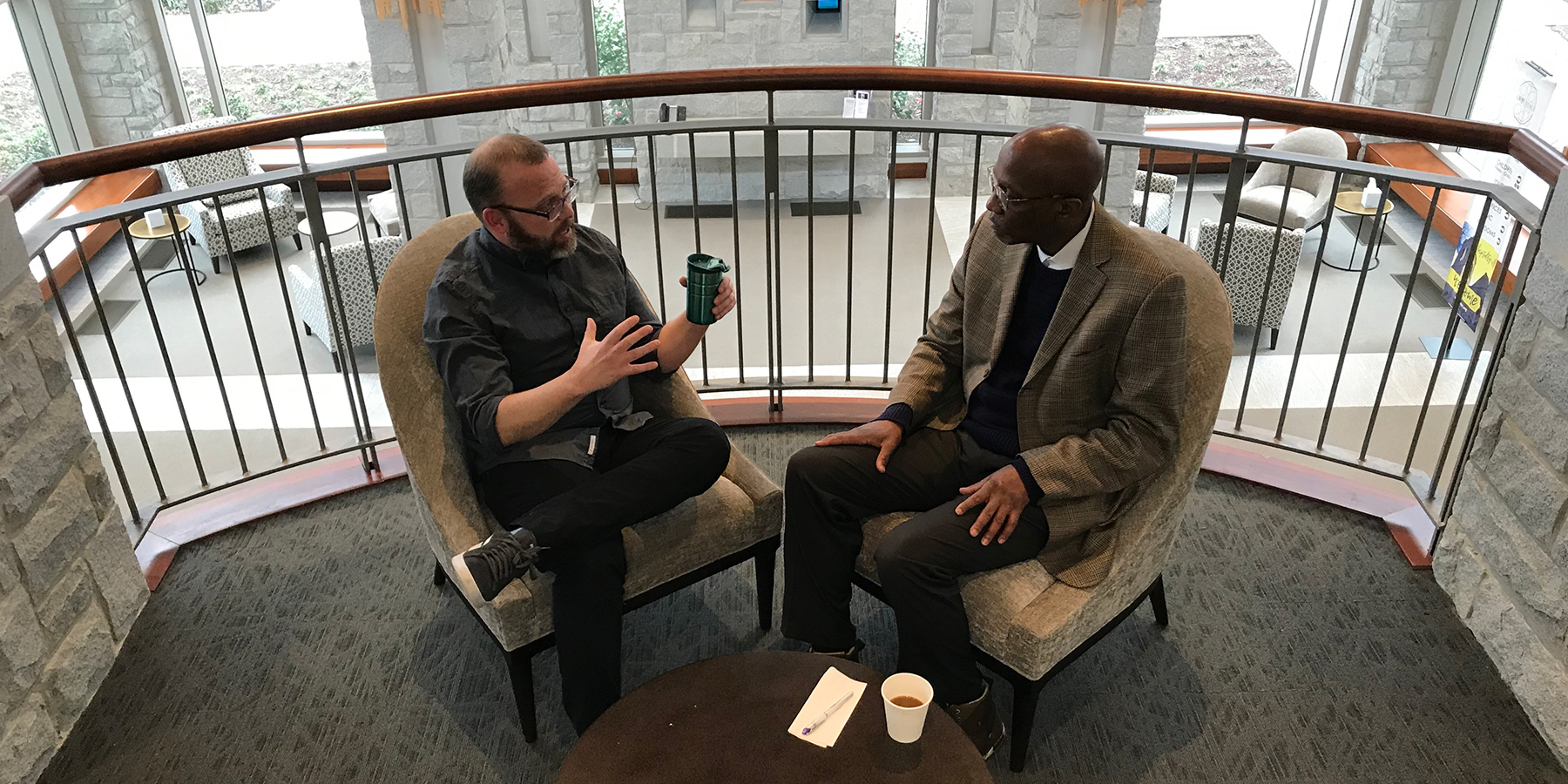 "The Rev. Dr. J. Herbert Nelson, II, Stated Clerk of the General Assembly, at right, interviews Presbyterian Disaster Assistance filmmaker David Barnhart during ""Coffee with the Clerk."" (Photo by Randy Hobson)"