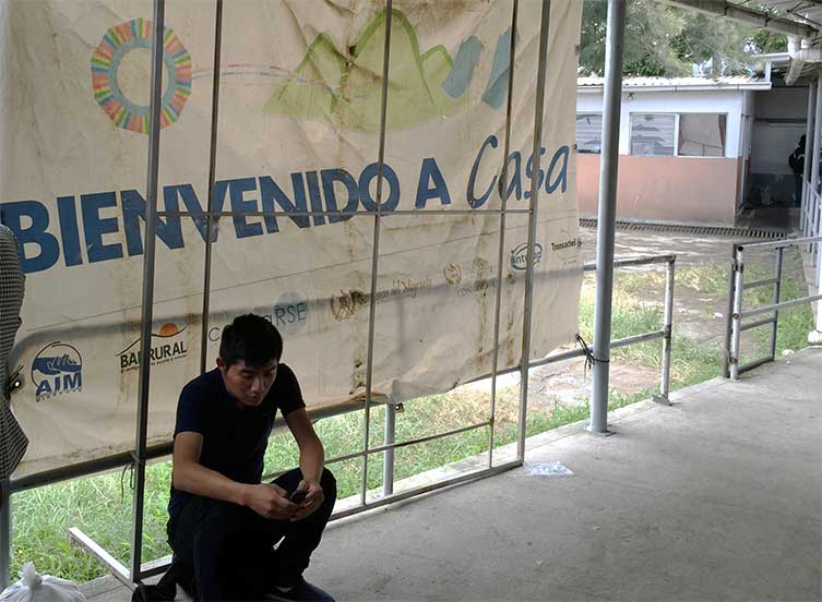 Deportee waits for assistance after being processed in a Guatemalan military facility