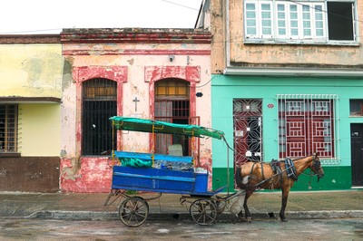 A horse cart from a distribution center next door sits in front of the Presbyterian Mission in Camagüey.