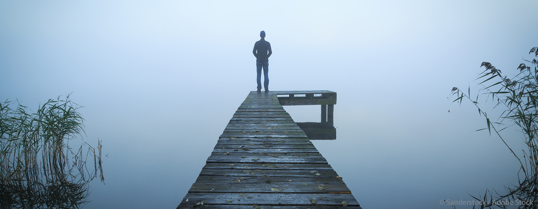 Image of man standing on pier