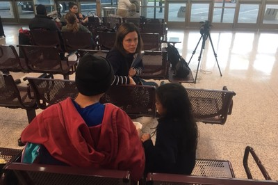 Amanda Craft, manager of Immigration Advocacy with the PC(USA) Office of the General Assesmbly, meets with a father and daughter at the McAllen, Texas bus station.