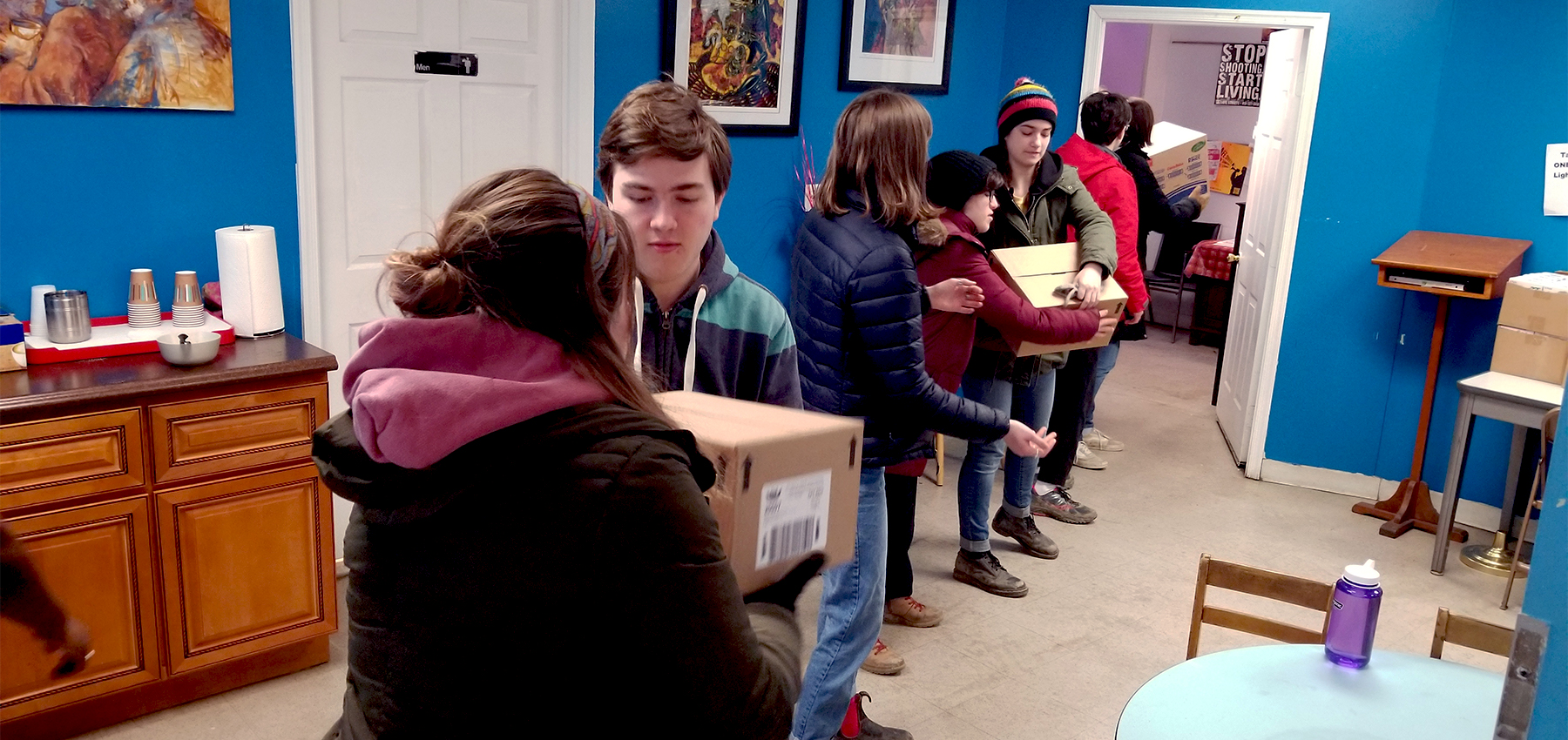 Youth from State College Presbyterian Church move boxes of food at Amazing Grace Lutheran Church in Baltimore earlier this year as part of the Hands and Feet initiative. Photo provided.