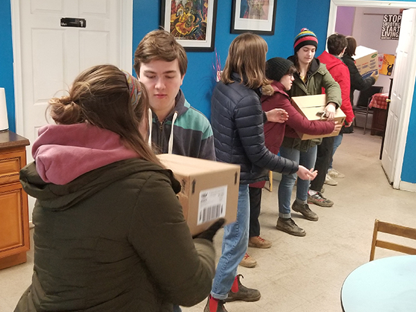 Youth from State College Presbyterian Church move boxes of food at Amazing Grace Lutheran Church in Baltimore during a recent mission trip. Photo provided.