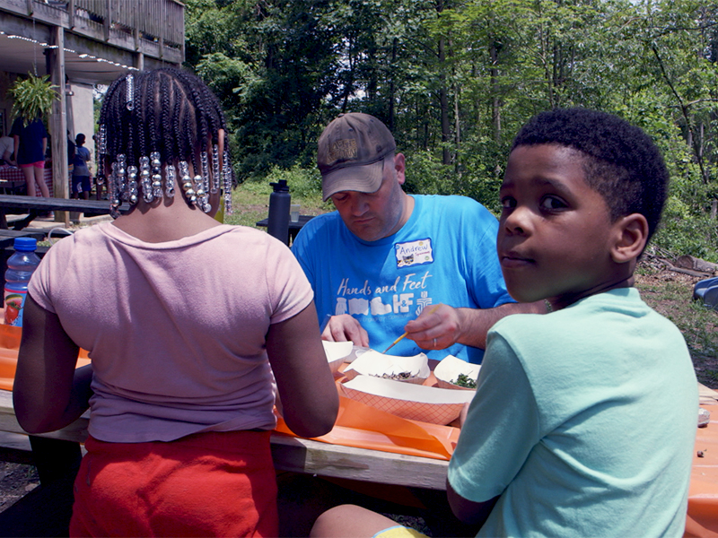 Andrew Yeager-Buckley, who oversees the Hands and Feet initiative, participates in craft activities during a visit to Baltimore earlier this year. Photo by Randy Hobson.