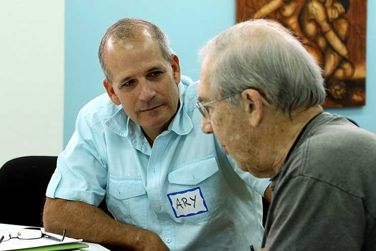 Ary Fernández talks with David Cassie at a morning gathering