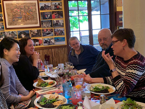 Several students and staff of San Francisco Theological Seminary continued the conversation with the Rev. Cindy Kohlmann over a meal. Photo by Scott Clark.