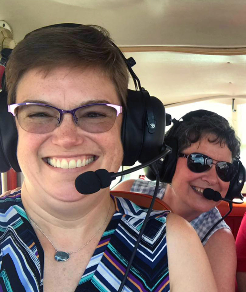 The Reverend Cindy Kohlmann joins a group for an aerial tour of some of Louisiana's marshes that are disappearing because of climate change and human involvement. Photo provided.