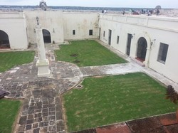 The interior courtyard and former prison cells at San Severino Castle, one of the first ports of entry of the transatlantic slave trade. It's now home to the UNESCO Slave Route Museum. Photo by Molly Casteel