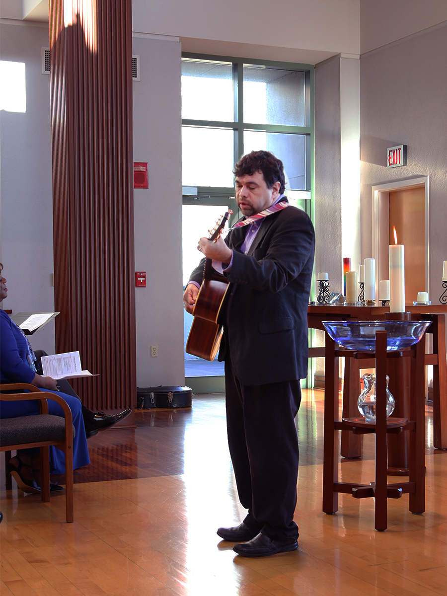 David Gambrell, associate for worship with the Presbyterian Mission Agency's Office of Theology and Worship, led music during a memorial service for the Reverend Robina Winbush and Mike Miller at the Presbyterian Center. Photo by Randy Hobson