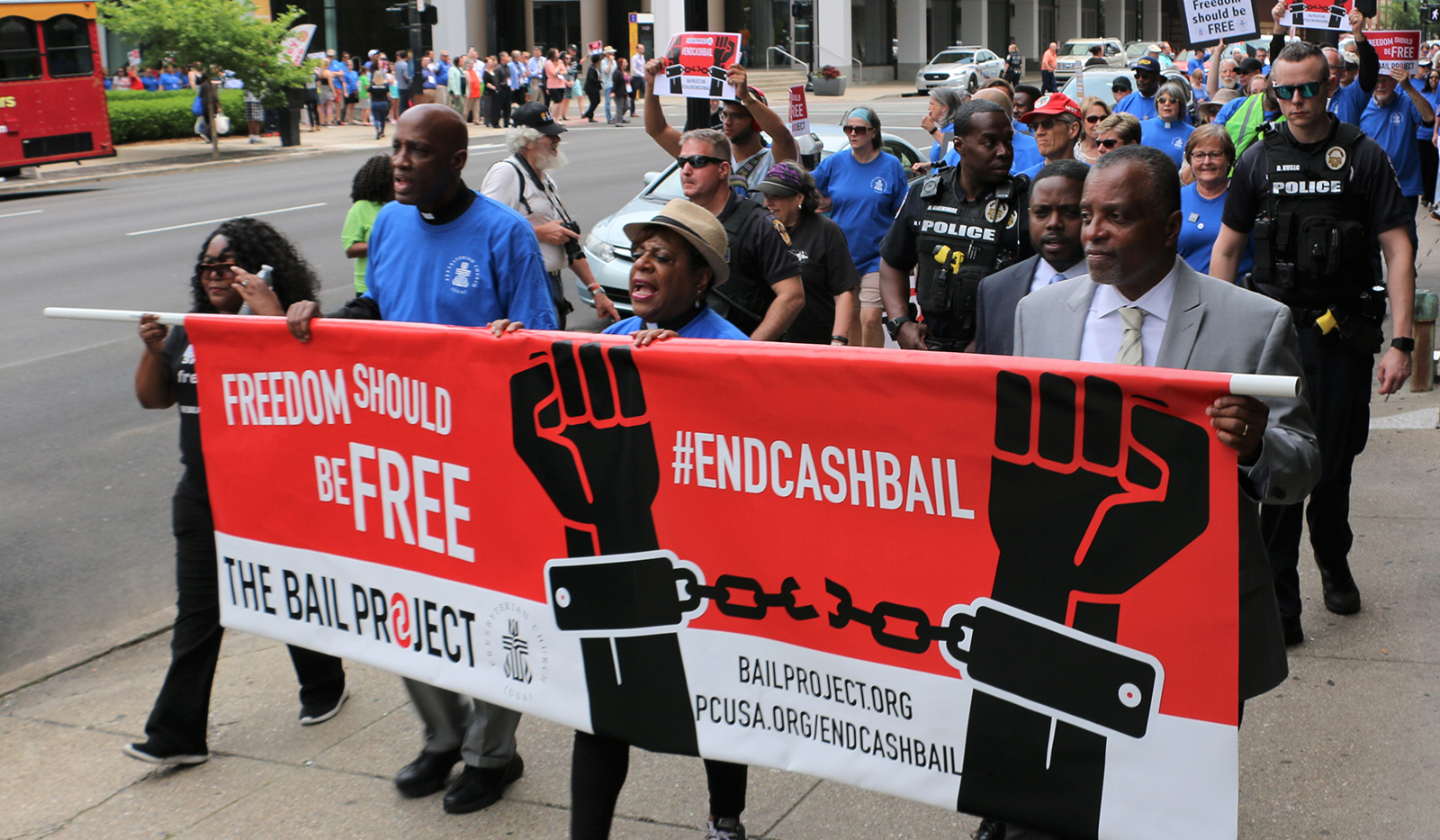 More than 250 people marched in Louisville in June 2019, to end cash bail. Left to right, Shameka Parrish-Wright of The Bail Project; the Rev. Dr. J. Herbert Nelson, II; the Rev. Dr. Diane Moffett; and J. Phillip Thompson, deputy mayor of New York City. Photo by Tammy Warren