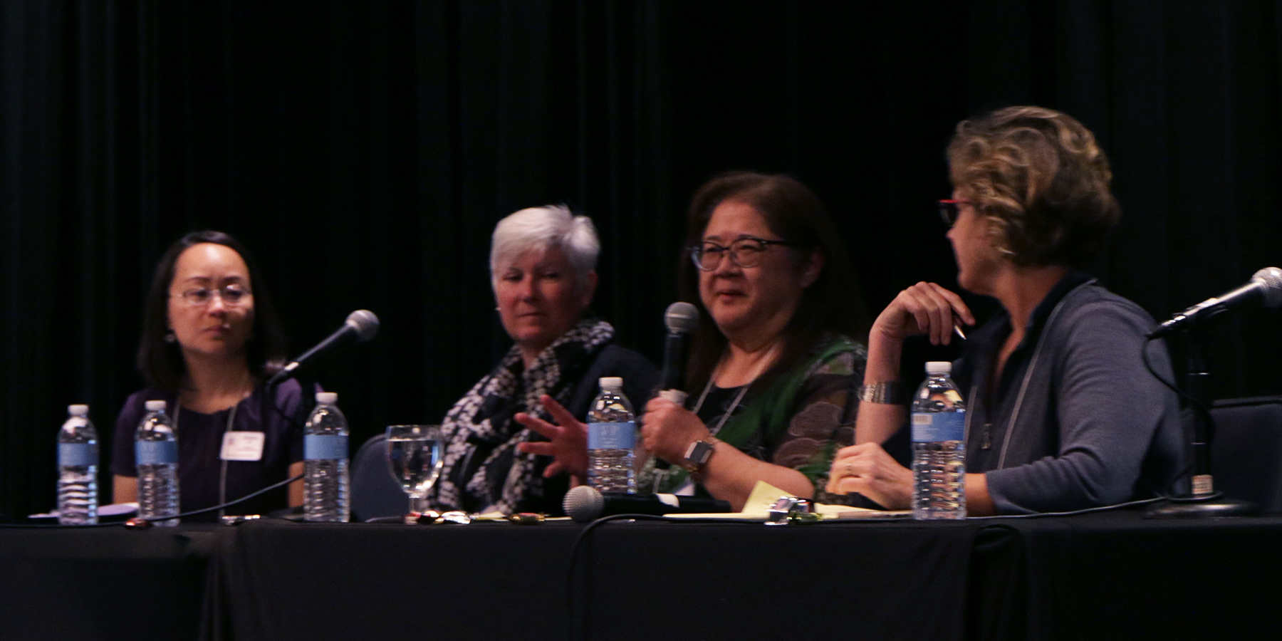 (left to right) Jihyun Oh; Laurie Griffith, associate director, Constitutional Interpretation at OGA; the Reverend Wendy Tajima, executive presbyter of San Gabriel Presbytery; and the Reverend Dr. Mary Westfall, transitional presbyter with the Presbytery of Sacramento, take part in a panel discussion during a Friday afternoon plenary. Photo by Rick Jones.
