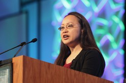 Jihyun Oh, moderator of Committee 7, Ecumenical and Interfaith Relations, addresses plenary during the 221st General Assembly (2014) of the PC(USA) in Detroit, MI on Thursday, June 19, 2014.
