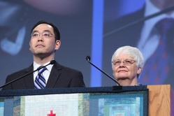 Stepnen Choi (left) and Ginny Sheets (right), moderator and vice moderator of Committee 14, Middle East Issues, addressed plenary VII at the 221st General Assembly (2014) of the PC(USA) in Detroit, MI on Thursday, June 19, 2014.