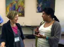 Heidi Hadsell (left), president and professor of social ethics of Hartford Seminary; talks with Damayanthi Niles, professor of constructive theology and acting dean at Eden Theological Seminary.
