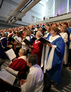 A picture of the large choir singing