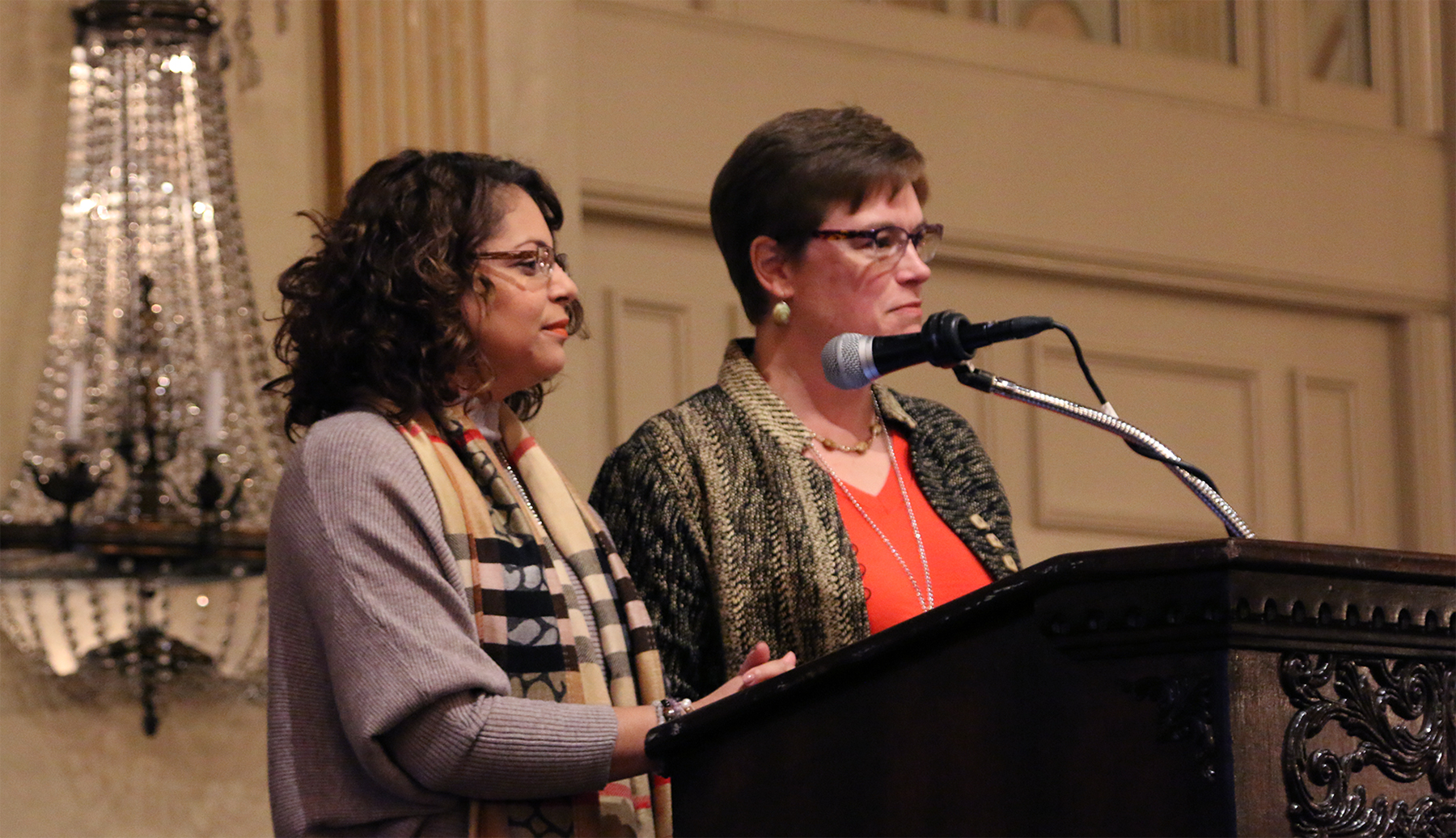 Elder Vilmarie Cintron-Olivieri and the Rev. Cindy Kohlmann, Co-Moderators of the 223rd General Assembly announce their decision to change books for their book study program at the Moderators' Conference in Louisville, Kentucky. Photo by Rick Jones.