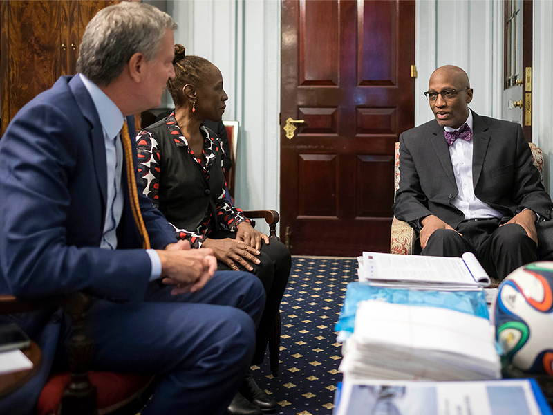The Reverend Dr. J. Herbert Nelson, II, spends time with Mayor Bill de Blasio and his wife Chirlane McCray during a recent visit. Photo provided.