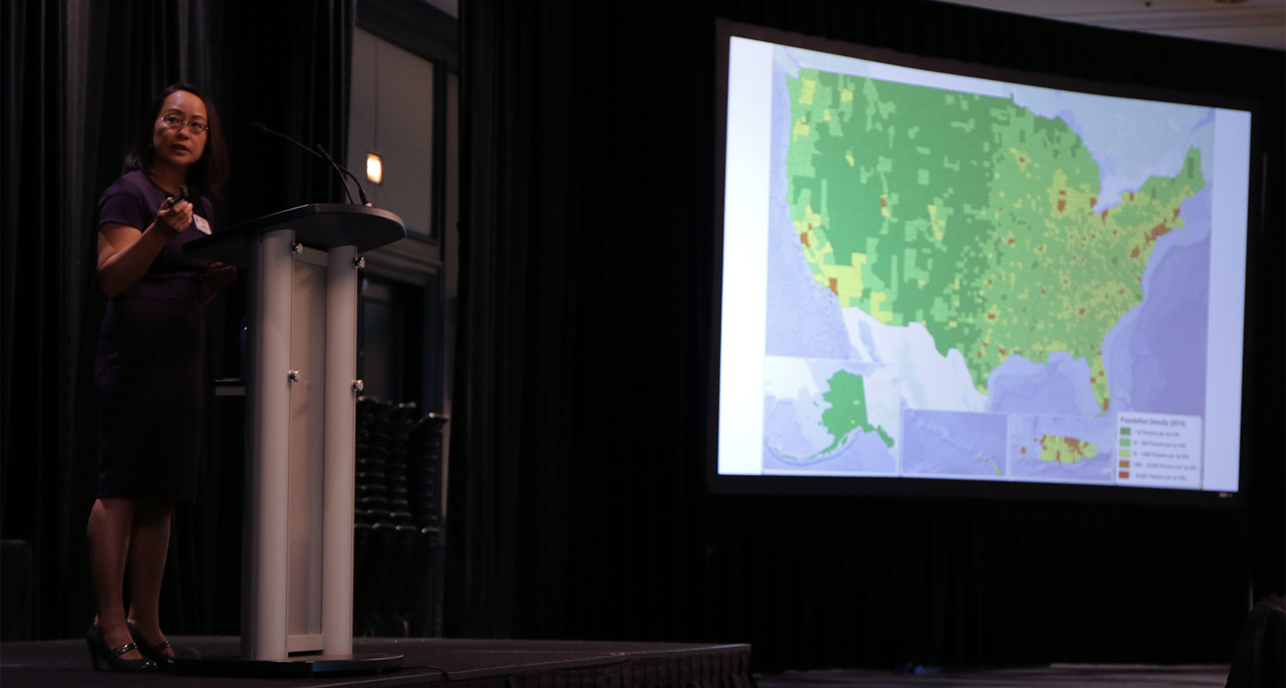 Jihyun Oh, director of Mid Council Ministries, illustrates a population shift in the U.S. over a ten-year period. Photo by Fred Tangeman.