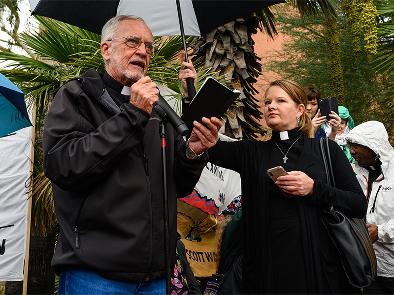 Human Rights Activist and Presbyterian Pastor John Fife speaks at the gathering alongside Rev. Alison Harrington, Pastor of Southside Presbyterian Church in Tucson. Photo by Gregg Brekke.