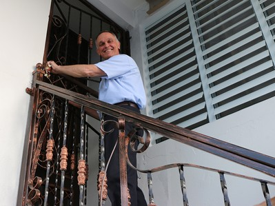 Rev. Jim Kirk, PDA associate for domestic disaster response, opens the door to Angels' Lodge, a new volunteer village at the Presbyterian Church in Ańasco