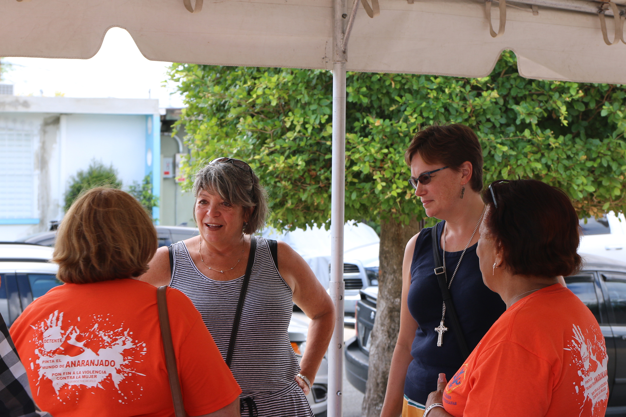PDA Director, Rev. Dr. Laurie Kraus and Rev. Cindy Kohlmann, Co-Moderator of the 223rd General Assembly (2018) of the PC(USA), meet with volunteers at Bayamón Presbyterian Church. Photo by Rick Jones.