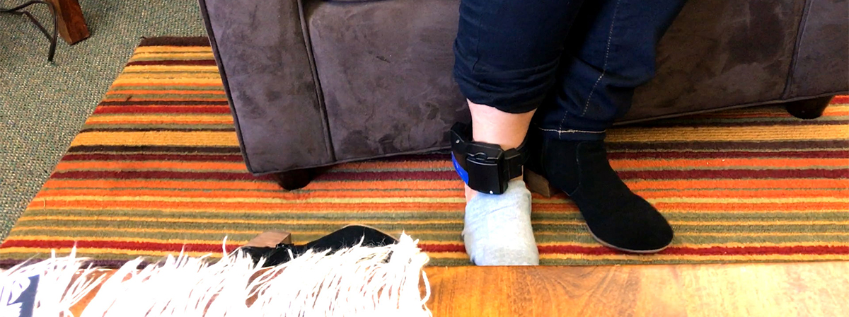 Leonor Garcia shows the ankle bracelet ICE requires her to wear.