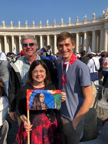 Norma Thieman holds a picture of her ancestor, Maria Katharina Kasper, in St. Peter's Square at the Vatican, along with her husband, Bob (left) and Kevin Herrmann (right) with the Diocese of Germany.