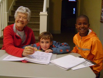 Irene Orando with two kids at the Trinity Afterschool Program in 2012.