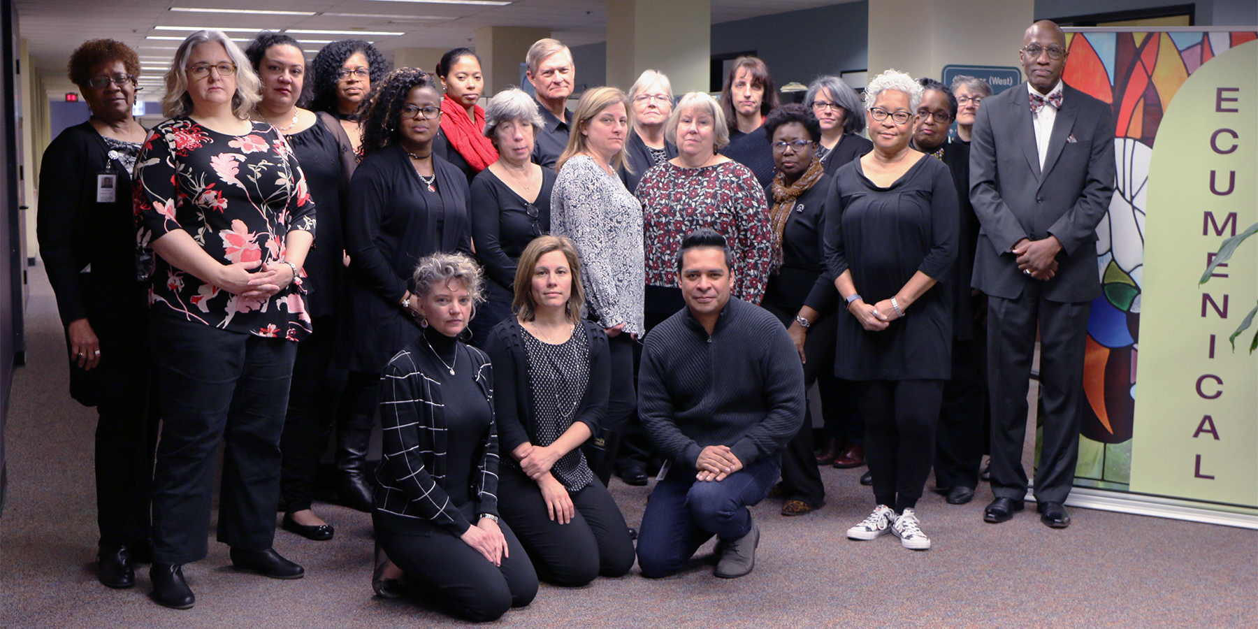 "Office of the General Assembly staff dress in black to commemorate the ""Thursdays in Black Campaign"" to raise awareness of the abuse of women. Photo by Randy Hobson."