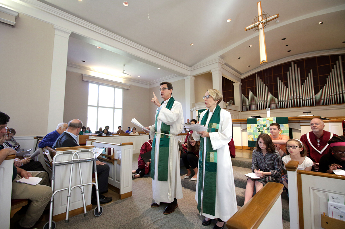 Forest Hill Presbyterian Church senior pastor, Rev. Dr. John Lentz, and associate pastor, Rev. Lois Annich make announcements during worship service.