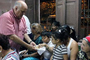 Edelberto Valdes serves communion to worshipers at the Presbyterian Mission in Holguin.