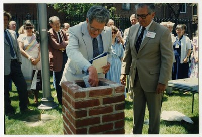 Depositing items in the time capsule, Summer 1989.