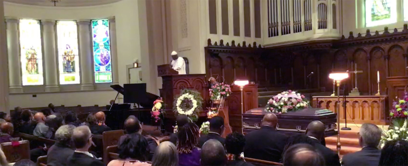 Rev. Dr. Mark Ogunwale Lomax delivers the eulogy at the funeral. Photo provided.